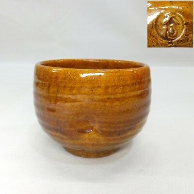 B666: Japanese smallish amber tea bowl of OHI pottery with appropriate sign