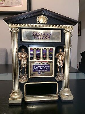 Caesars Palace Franklin Mint Slot Machine with coins