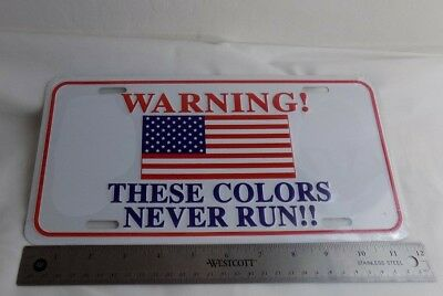 """American Flag vanity license plate Says """"Warning! These Colors Never Run!!"""""""