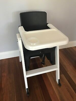 AGE HI-LO adjustable high chair, used, good condition.