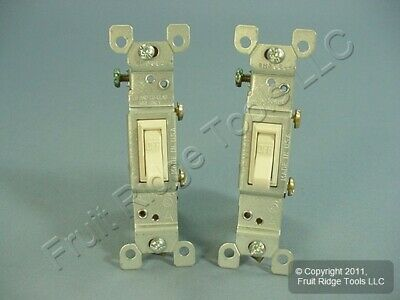 2 Leviton Lt Almond Framed Toggle Wall Light Switches Single Pole 15A 1451-2T