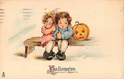 1910? Jack O'Lantern Girl & Boy Halloween post card Tuck