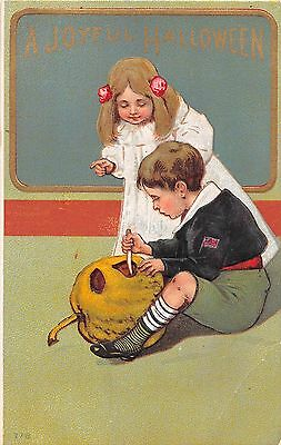 c.1910 Boy & Girl Carving Jack O'Lantern Halloween post card as is