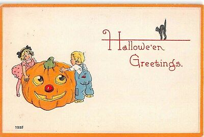c.1915 Large Jack O Lantern Boy & Girl Halloween post card