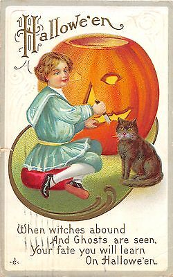c.1910 Boy Carving Jack O'Lantern Black Cat Halloween post card