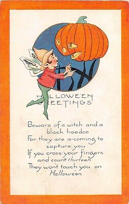 1923 Jack O Lantern & Fairy Halloween post card