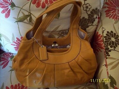 Coach Leather Pleated And Framed Ergo Bag In Saffron