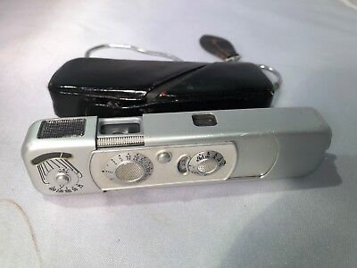 Minox B camera in a shiny black case, with chain.