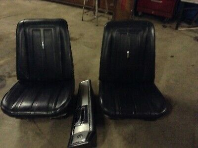 pair of black bucket seats out of 1966 nova  ss