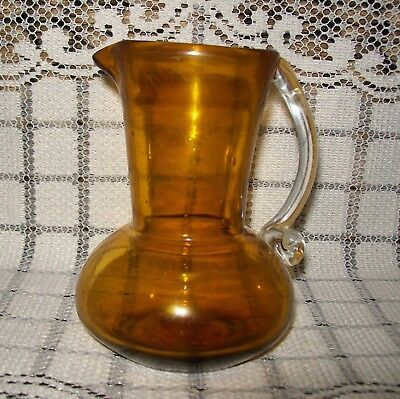 SMALL OLD SHABBY AMBER GLASS JUG clear handle (w/faults) 11.25cm