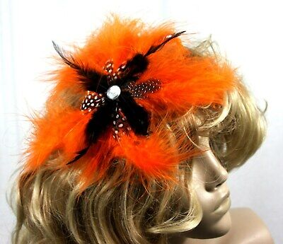 Large Orange all feather Fasinator mounted on a comb more colours in our store
