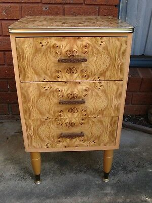 VINTAGE  RETRO 1970s 3 DRAW PINE WITH LAMINATED VANEER BEDSIDE CABINET ON LEGS.