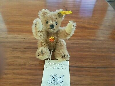 Minature steiff bear. 4 inches tall. In as new condition. Always kept behind gla