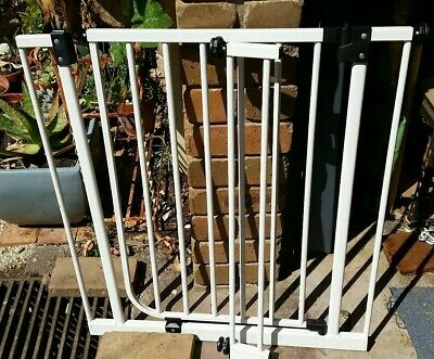 Child safety gate with extra attachment for wider doorway.