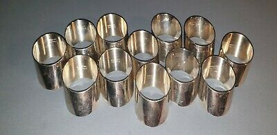 12 VINTAGE 80s STRACHAN AUST. OBLIQUE SILVERPLATED NAPKIN RINGS  VG USED COND.