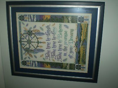 Framed completed cross stitch