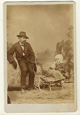 Slouching Dad Pulls Young Daughter On A Sled In Bellevue, Ohio (Cabinet Card)