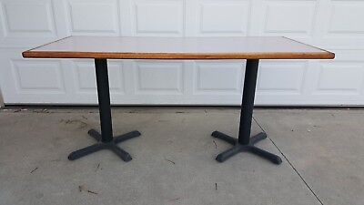 Restaurant table on 2 x-base legs, or - Legs only. LOCAL PICKUP.