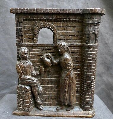 Nice Antique wood carving of a woman with wine or water for a man 18th. century