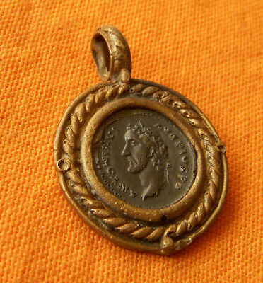A71. Roman style bronze and silver pendant.