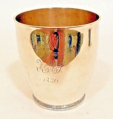 A small unseamed coin silver beaker, by William Moulton IV, Newburyport, MA.