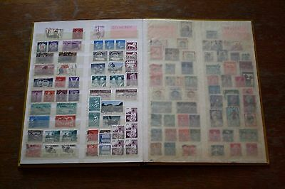 Album with 1000 worldwide old post stamps for collection
