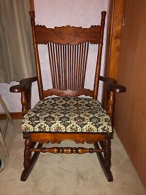 Antique cherry wooden rocking chair