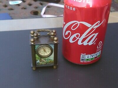 Miniature Omega Brass Mechanical Carriage Clock Fwo And Excellent Condition.