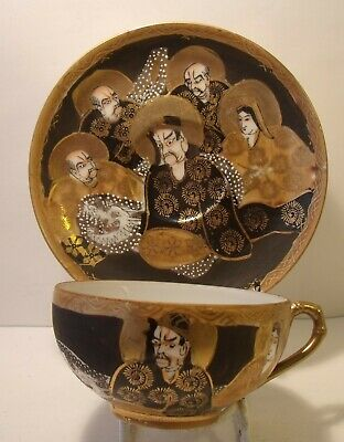 Japanese Satsuma Immortals Thousand Faces Eggshell Cup And Saucer (1)