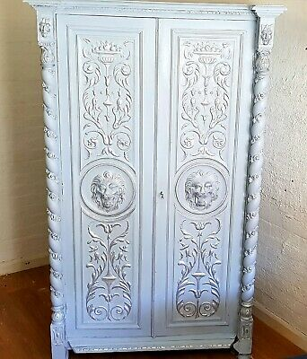 Renaissance Style Carved Wood Armoire With Carved Lion Heads Masks