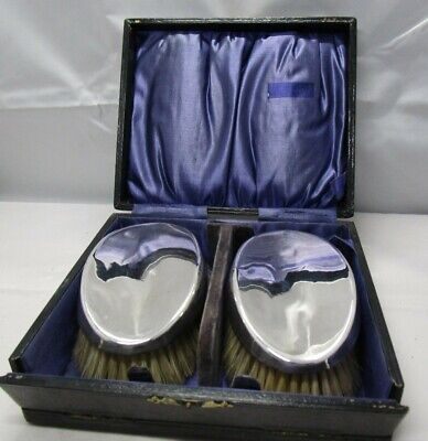Boxed pair of silver backed hair brushes. Birmingham 1924