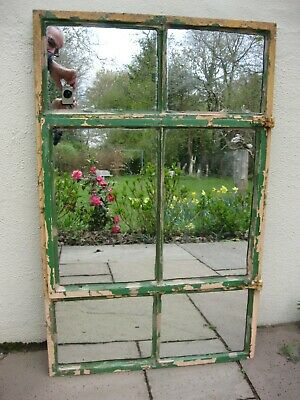 Vintage cast iron metal window frame from 1930s with later  mirror panels