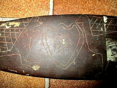 Aboriginal child's Woomera; carved decoration, collected 1920's
