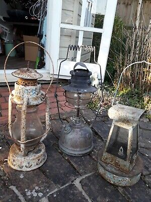 3 antique oil lamps.