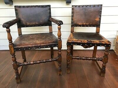 2 antique English oak chairs with original leather upholstery, turned legs and c