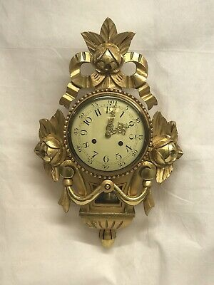 Gold Gilt Cartel Wall Clock Chimes On A Bell
