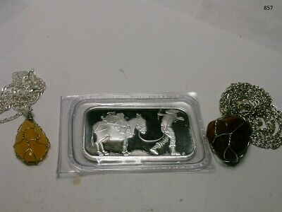 one 1 oz. SilverTowne Prospector and Donkey Silver Bar and 2 gemstone necklaces