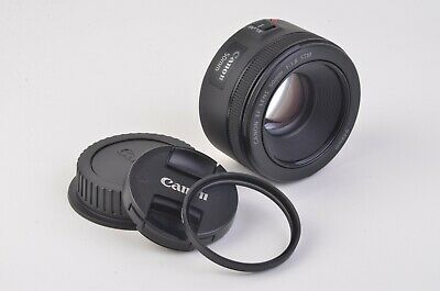MINT- CANON EF 50mm f1.8 STM w/HOYA UV FILTER AND LENS CAPS, VERY CLEAN