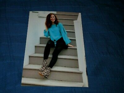 PRETTY REDHEAD MODEL w NICE SMILE POSING ON STEPS IN BLUE TOP-BLACK TIGHTS PHOTO