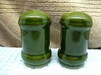 Tall green ceramic barrel shape salt & pepper set.