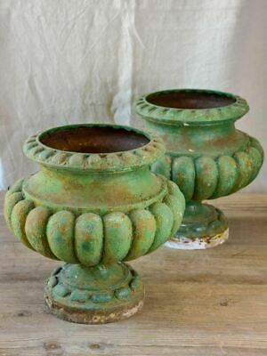 Pair of cast iron French antique garden urns with green patina