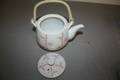 Japanese teapot of old pottery with pink flowers