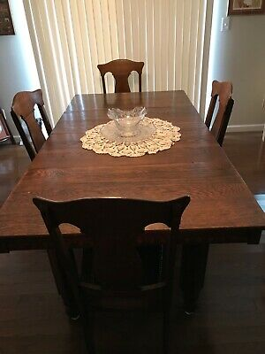 antique oak dining table and 4 chairs. Dark oak, 4 inserts expanding to 6ft