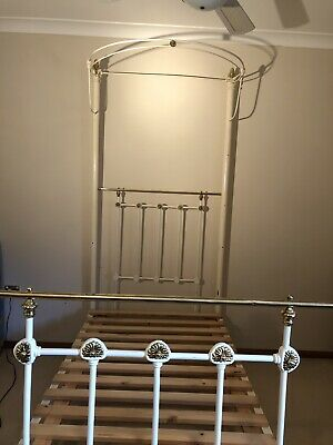 Original Antique cast Iron and brass bed..single, colour cream good condition