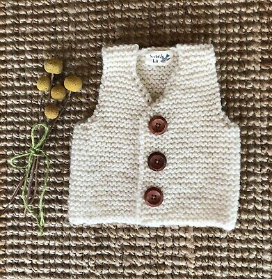 Baby's Hand Knitted Vest In White. Size 6-9 months.