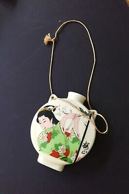 Vintage Asian Hanging Wall Vase Woman hanging prayer flag on cherry blossom tree