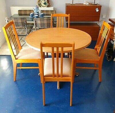 Parker Knoll extending teak circular round dining table with four chairs – Teak