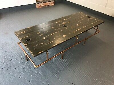 Coffee table with copper and brass legs old army vehicles hatch top