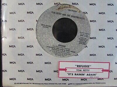 """TOM PETTY AND THE HEARTBREAKERS Refugee/It's raining 7"""" 45 + JUKEBOX STRIP NM"""
