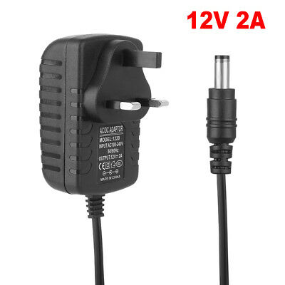 To Fit LED Strip CCTV Camera Power Supply Adapter Charger PLUG 12V 2A AC DC UK
